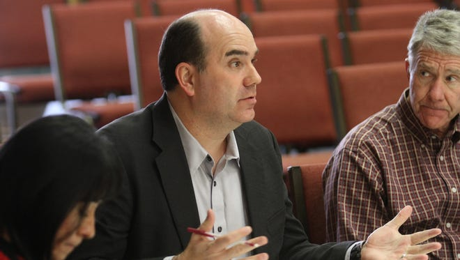 U.S. Housing and Urban Development enforcement analyst Jerry Creamer, center, talks Wednesday during a meeting at City Hall in Farmington while Assistant City Manager Bob Campbell listens.