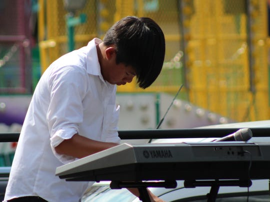 Ben Hoang is the keyboard player for the band TwoThirds & a Ghost.