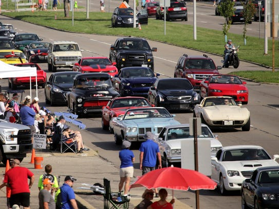 People drive their classic and custom cars along Woodward