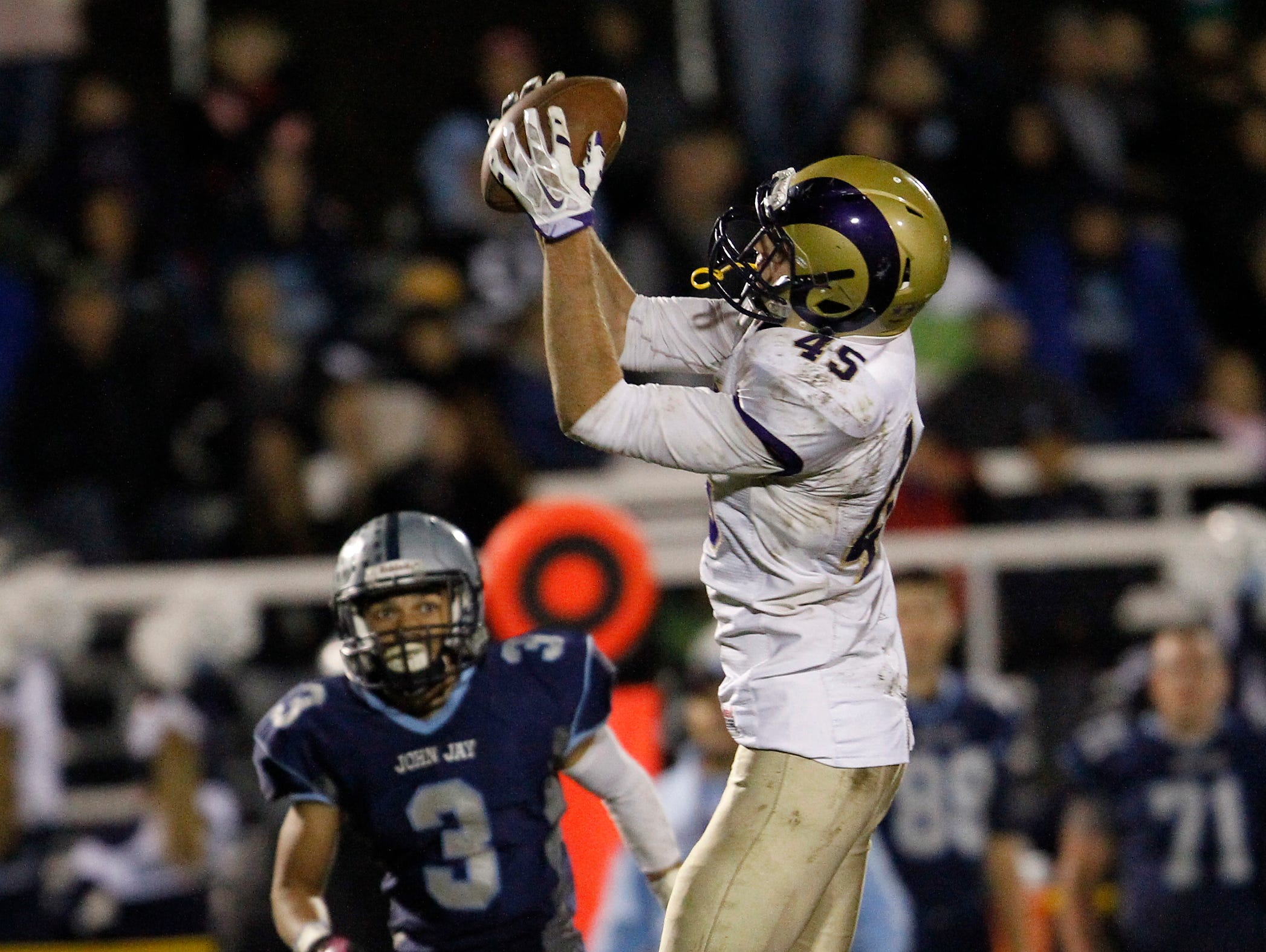 Clarkstown North's Martin Mulvey (45) makes a reception during their 21-7 loss to John Jay High School in the class AA semi-final football game in East Fishkill on Friday, Oct. 30, 2015.