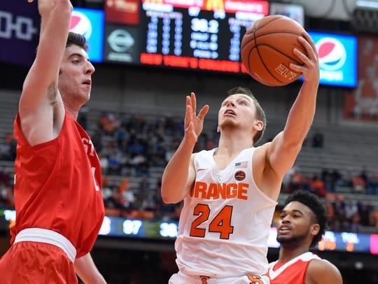 Syracuse Orange guard Shaun Belbey (24) shoots the