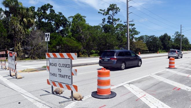Cars drive through the road work signs on Monday, July 2, 2018, as construction begins on 58th Avenue between 26th and 41st streets in Indian River County. The section of 58th Avenue from 26th to 49th streets will be under construction for about six months. At the beginning of 2019, construction will begin on the section of 58th Avenue between 57th Street and County Road 510. Local traffic and those conducting business are permitted to use the road. All other traffic is urged to seek an alternate route.