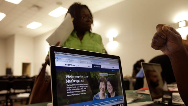 A Floridian gets assistance with the health care exchange site on Oct. 3.