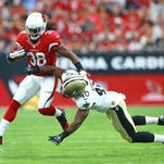Arizona Cardinals running back Andre Ellington (38) is tackled by diving New Orleans Saints cornerback Delvin Breaux (40) in the first quarter at University of Phoenix Stadium. Mandatory Credit: Mark J. Rebilas-USA TODAY Sports