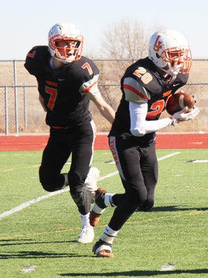La Junta High School's Nathan Frankmore (7) hands off to Anthony Torrez (20) in a game played last season. CHSAA approved variances for fall football to be played. However, La Junta had not officially announced it would play.