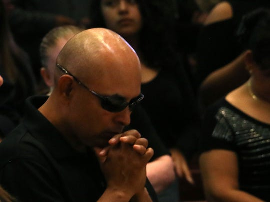 Carla Gabrielle Ballesteros' father Carlos Ballesteros Barajas prays during her funeral at the Saint Therese Church of the Little Flower in Reno on May 31, 2018.