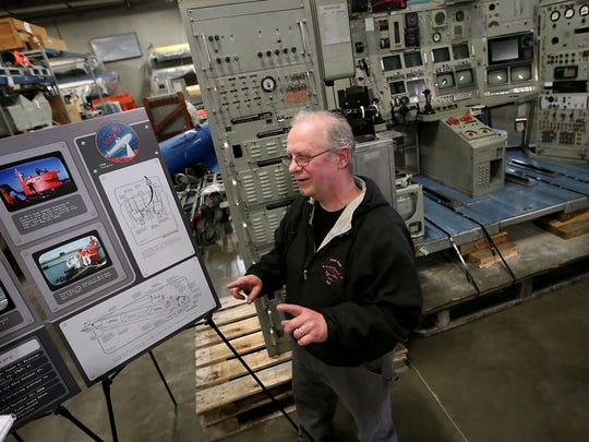 Charles Dastrup, a marine mechanic in Shop 30 at PSNS, talks about what it was like saving the console of the Naval Research Vessel 1, on display behind him at the Keyport Undersea Museum on Tuesday.