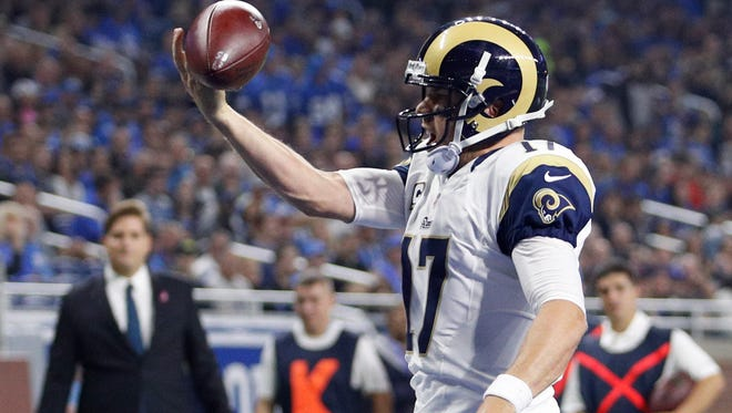 Rams quarterback Case Keenum celebrates his rushing touchdown during Los Angeles' loss at Detroit on Sunday.