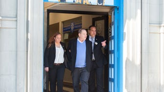 Harvey Weinstein leaves the New York City Police Department's First Precinct in handcuffs on his way to a Manhattan courthouse for his arraignment on May 25, 2018.