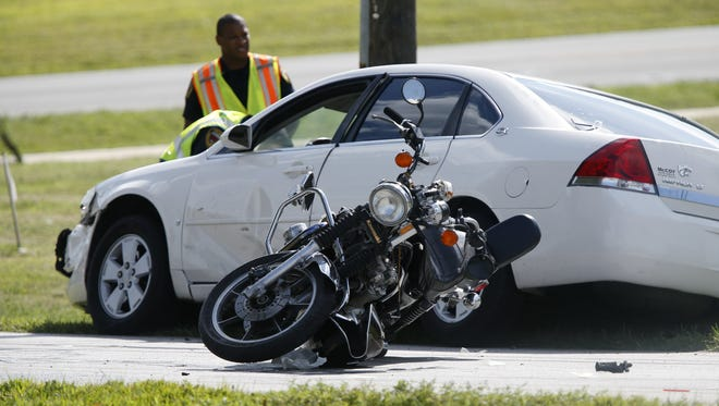 Police investigate a car vs. motorcycle crash on South Park Avenue on Aug. 24.