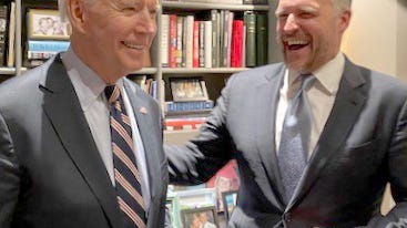President-elect Joe Biden shares a laugh with deputy campaign manager Rufus Gifford, right.