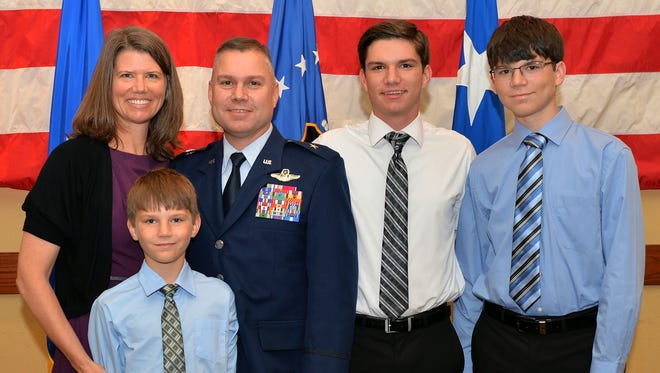 The Holt family during the ceremony Nov. 3, 2016, at Hurlburt Field, Florida.  Holt hails from Alamogordo and has served in the Air Force for 25 years.