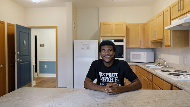 Emmanuel Kendrick, 21, is all smiles at his new apartment in the new Marsh Brook Place on the Southeast Side.