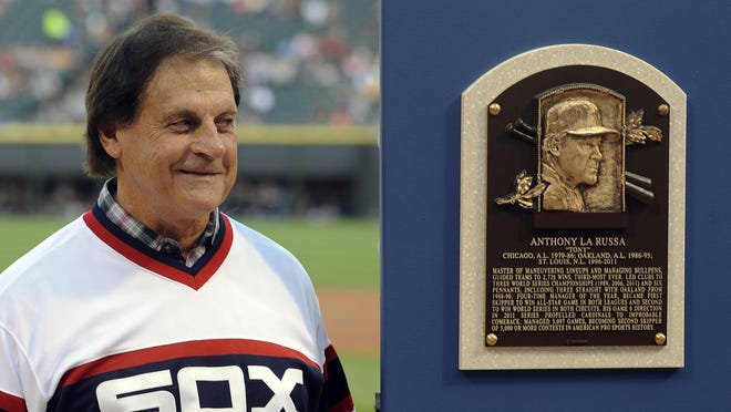 Tony La Russa stands with his Baseball Hall of Fame plaque before a 2014 Chicago White Sox game. La Russa is returning to manage the Chicago White Sox.