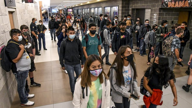 Garden City High School students make their way through the main hallway to their classes Tuesday morning on the first full day of school for the 2020-21 school year. Tuesday was the first day for all USD 457 students attending in-person classes to be back in the schools.