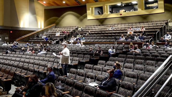 John Wiese speaks at the USD 457 Board of Education meeting Monday in favor of the school district approving a revision to the Athletics and Activities Level 6 Protective Measures at Garden City High School's auditorium. The board declined the changes.
