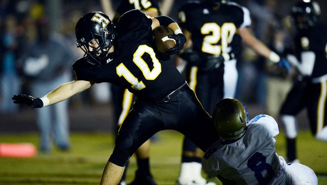 Hendersonville running back Jack Towe (10) runs past Brentwood cornerback Spencer Schwartz (8) for a 1-yard touchdown in the first quarter Saturday.