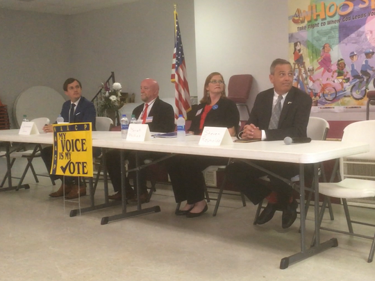 Four Congressional District 4 candidates sit at table before start of an NAACP forum: From left to right, the candidates are Christopher Hale, D-Murfreesboro; Jack Maddux, R-Cleveland; Maria Phillips, D-Murfreesboro; and Steven Reynolds, D-Murfreesboro.