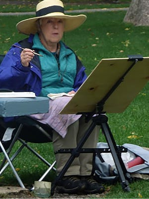 "Artist Judy Weyenberg participates in last year's ""Paint the Town"" event in Florence."