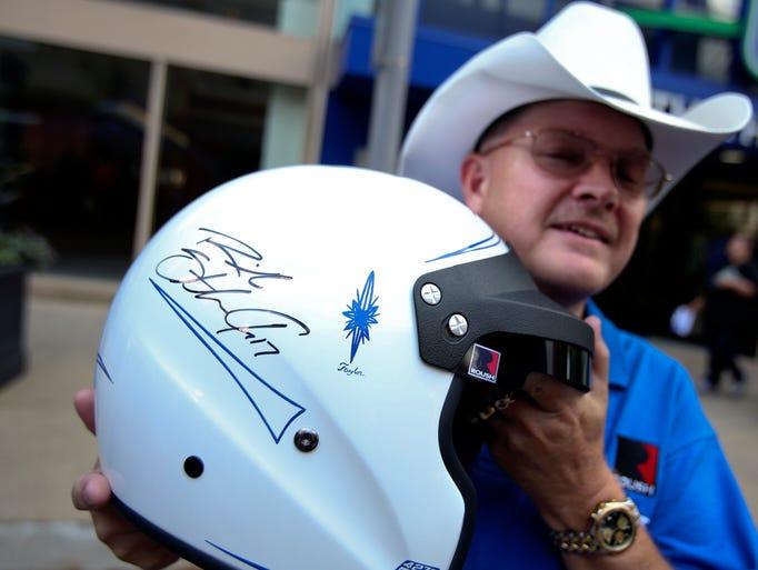 Steve Fetter shows off the helmet he got autographed by Ricky Stenhouse Jr.  June 26, 2014
