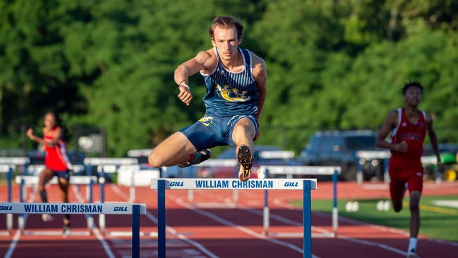 William Chirsman's Wyatt Leutzinger runs to a victory in the 300-meter hurdles in the Independence School District Track and FIeld Meet Thursday at William Chrisman High School. Leutzinger also won the pole vault for the Bears.