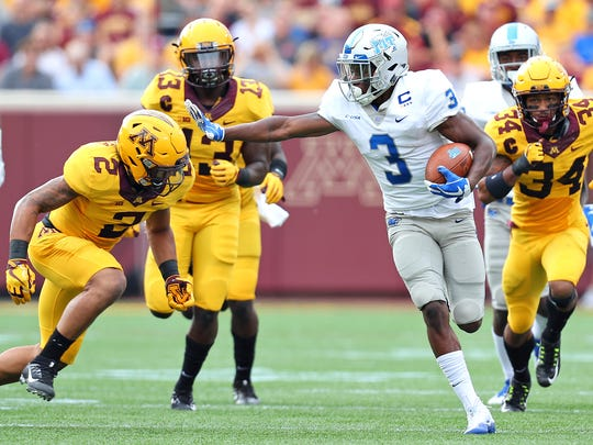 MTSU wide receiver Richie James runs the ball in a game against Minnesota at TCF Bank Stadium on Sept. 16, 2017.