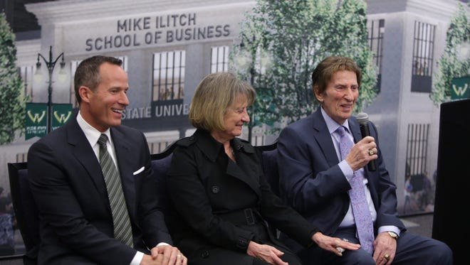 (Left to right) Christopher Ilitch and Marian Ilitch listen as Mike Ilitch speaks during a 2015 press conference announcing their $40 million donation to build the Mike Ilitch School of Business at the McGregor Memorial Conference Center on the Wayne State University campus in Detroit