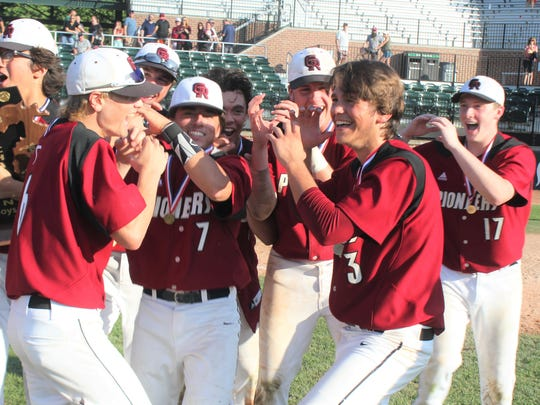 Riverview Gabriel Richard players celebrate after winning the Division 3 state championship game on Saturday, June 16, 2018.