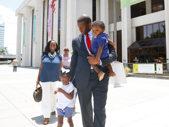 Tallahassee mayor Andrew Gillum walks alongside his