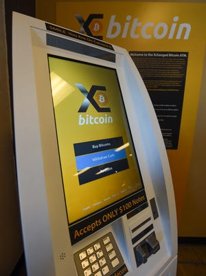 A bitcoin ATM machine, the first in the Northern Mariana Islands, was unveiled at Brewed Awakenings in Harmon Dec. 9, 2017.