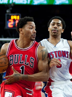 Chicago Bulls guard Derrick Rose (1) drives to the basket against Detroit Pistons guard Spencer Dinwiddie (8) during the second quarter of the Pistons' 100-91 win Friday at the Palace.