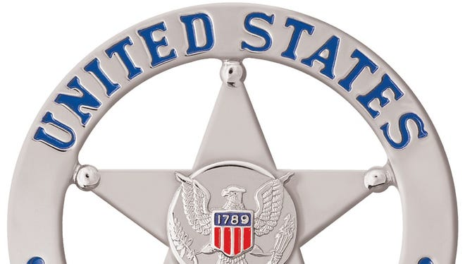 """A file photo of the United States Marshals Service badge. Local law enforcement arrested 17 felony fugitives in Reno as part of a national crime reduction effort. Five were considered """"worst of the worst."""""""