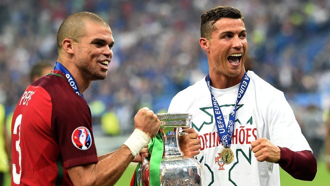 Pepe and Cristiano Ronaldo, right, of Portugal react after winning the UEFA Euro 2016 final against France on July 10, 2016.