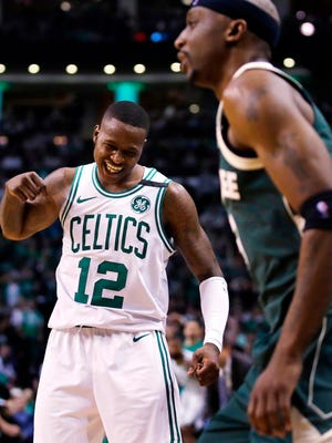 Boston Celtics guard Terry Rozier (12) celebrates after a basket against the Milwaukee Bucks during the fourth quarter of Game 7.