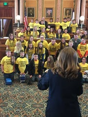 "Students wearing ""school choice now"" T-shirts pose for a photo at the Iowa Statehouse in April 2017. An estimated 900 students and parents attended a school choice rally."