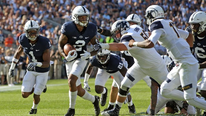 Penn State's Marcus Allen (2) runs with the ball on Sept. 30 after recovering a fumble during the first half of an NCAA college football game against Kent State in State College, Pa. The Nittany Lions (2-2, 0-1 Big Ten) will need more of that from Allen and fellow safety Malik Golden against Minnesota (3-0, 0-0 Big Ten) and its two-headed rushing attack as Penn State grasps for momentum in a season that's soured quickly thanks to a long list of injuries.