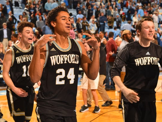 Wofford Terriers guard Nathan Hoover (10) and forward Keve Aluma (24) run off the floor after defeating the North Carolina Tar Heels at Dean E. Smith Center.