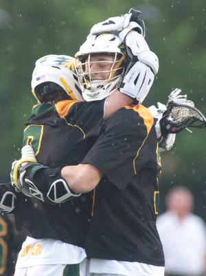 St. Xavier attacker Keegann Puffer hugs St. Xavier midfielder Patrick Anderson after Anderson scores the third goal of the game against Trinity in the Kentucky highs school state lacrosse championship played at St. Xavier. May 18, 2018