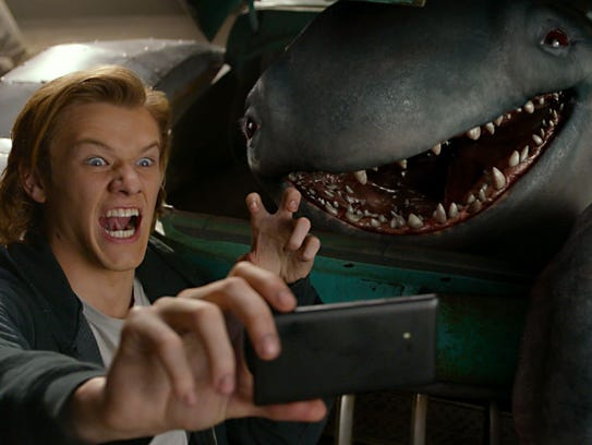 Tripp (Lucas Till) and monster pal Creech cheese it