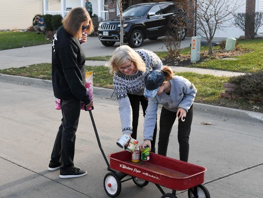 Des Moines residents work together on Nov. 26, 2017, to collect goods for a donation to a food bank.