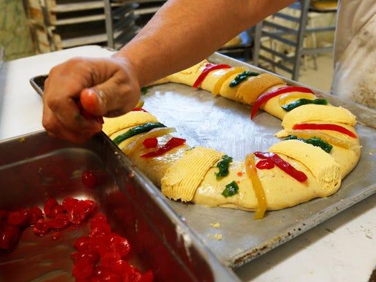 One of several bakers at El Fenix Bakery in El Paso's