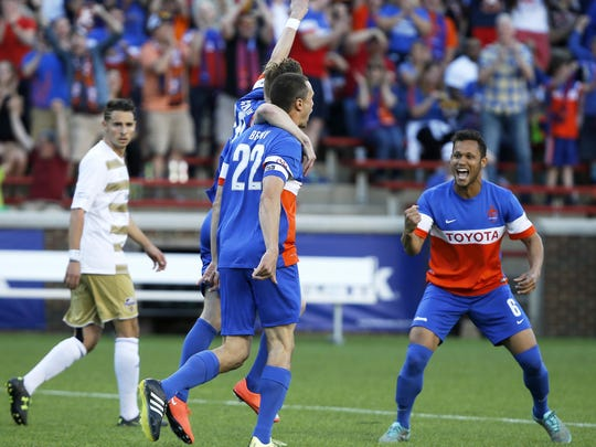 This season, FCC will have former Louisville City players Aodhan Quinn and Kadeem Dacres. Shown here, FCC's Kenney Walker, right, celebrates a goal by Austin Berry against Louisville.