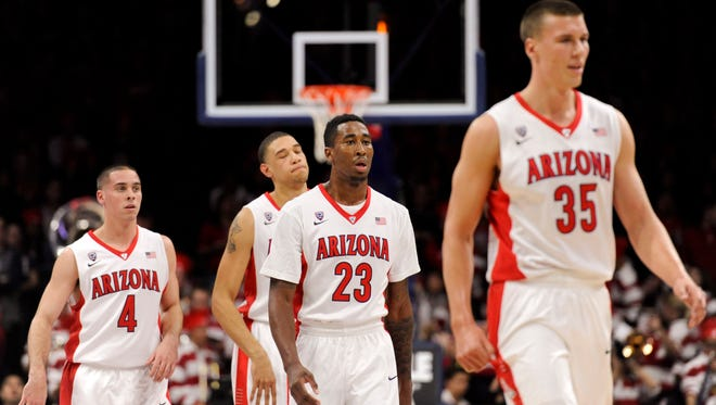 Arizona Wildcats walk to the bench during the first half against Colorado.
