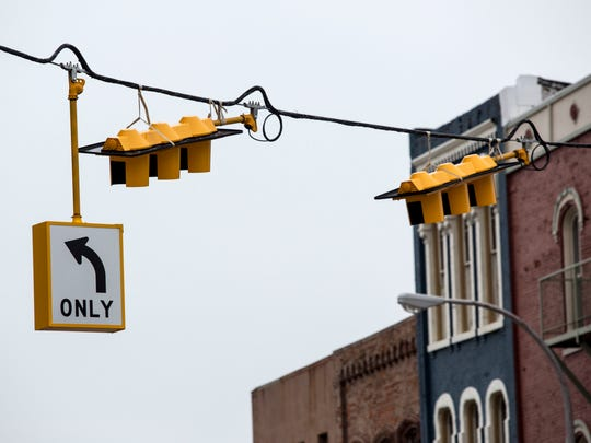 New signals hang Wednesday, March 23, 2016 at the intersection of Military and Water streets in downtown Port Huron. Work on the intersection is expected to be completed in early to mid-May.