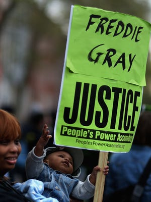 Hundreds of demonstrators rally in front of the Baltimore Police Western District station after marching from Baltimore City Hall to protest against police brutality and the death of Freddie Gray April 23, 2015, in Baltimore.