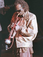 American jazz trumpeter Miles Davis is shown in concert