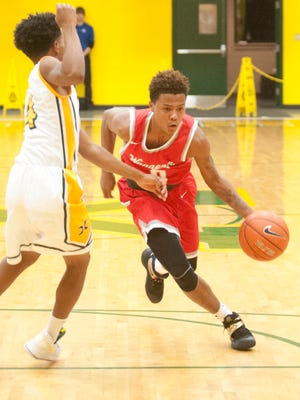 St. Xavier guard James Taylor tries to slow down Waggener guard Ron Fell.13 December 2016
