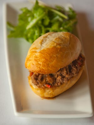 Volare Restaurant's new Hot Italian Beef Slyder made with braised certified Angus beefsteak, onions, peppers, served  au jus on a hoagie roll and accompanied by an arugula salad dressed with olive oil, basil, lemon, garlic and parmesan cheese.06 September 2017