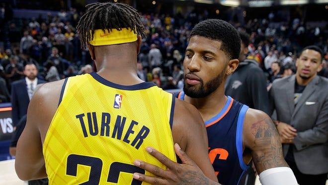 Oklahoma City Thunder Paul George (13) greets Indiana Pacers  Myles Turner (33) following their game at Bankers Life Fieldhouse Wednesday, Dec 13, 2017. The Oklahoma City Thunder defeated the Indiana Pacers 100-95.