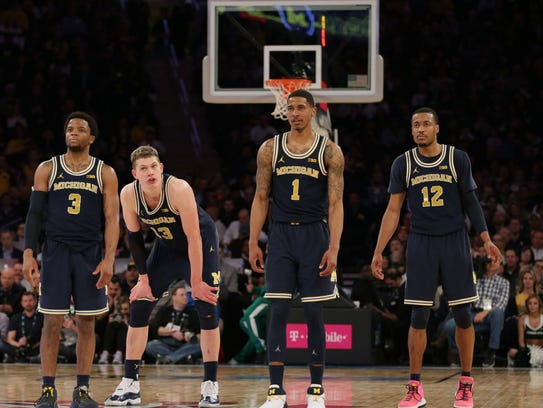 Michigan guard Zavier Simpson (3), forward Moritz Wagner (13) and guards Charles Matthews (1) and Muhammad-Ali Abdur-Rahkman (12) react against Michigan State during the second half of a semifinal game of the Big Ten Tournament at Madison Square Garden.